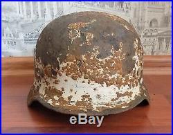 WW2 German Helmet M35 Wehrmacht Stahlhelm in winter camo coat