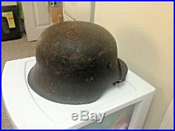 WW2 German Helmet Van Hoof with leather liner, chin strap, partial decal on side