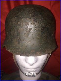 WW2 German M35 helmet in original paint. Native collection. Original