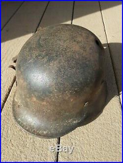 WW2 German M40 Combat Helmet with liner & strap, battle-damaged
