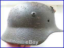 WW2 Helmet of a German soldier damaged in battle, Eastern Front WWII