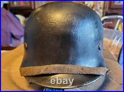 Ww2 M35 German helmet with liner and chinstrap stamped NS62